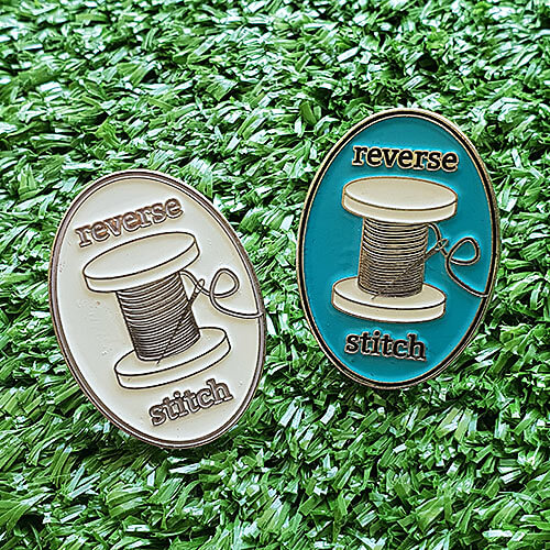 reverse stitch collectable pin